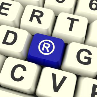 Free Stock Photo of Registered Computer Blue Key Showing Patent Or Trademark