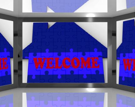 Free Stock Photo of Welcome House On Screen Showing Welcoming Guests