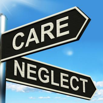 Free Stock Photo of Care Neglect Signpost Shows Caring Or Negligent