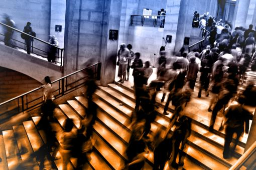 Free Stock Photo of People at Underground Subway Station Climbing Stairs - Blurry Looks