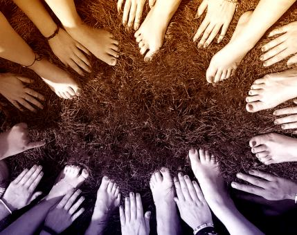 Free Stock Photo of All Together - People Joining Hands and Feet in a Circle