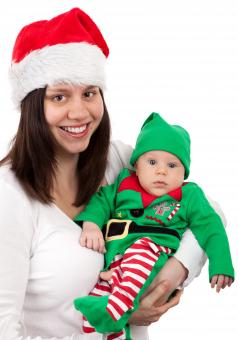 Free Stock Photo of Mother and Baby Dressed for Christmas