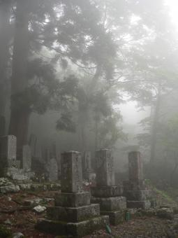 Free Stock Photo of Buddhist gravestones in the mist at a mountain temple