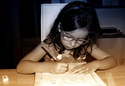 Free Stock Photo of Little Girl Doing Homework