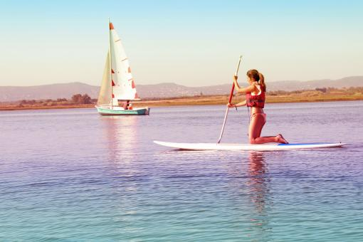 Free Stock Photo of Watersports - Girl Practicing on Paddle Board