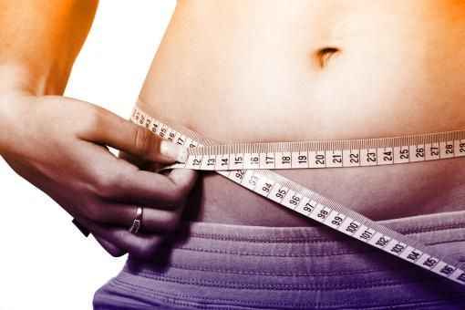 Free Stock Photo of Woman Measuring Waistline - How to Lose Weight Fast