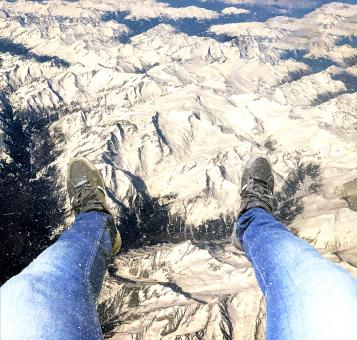 Free Stock Photo of Feet hanging over the Alps