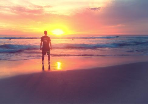 Free Stock Photo of Young Man at Sunset on the Beach