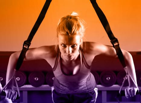 Free Stock Photo of Young Attractive Woman Training with HTRX Fitness Straps in the Gym