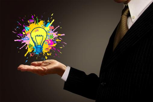 Free Stock Photo of Ideas at Hand - Businessman and Painted Lightbulb