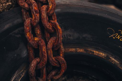 Free Stock Photo of Rusty Chain on Rubber Tire