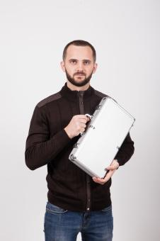 Free Stock Photo of Man Holding a Case