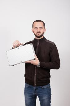 Free Stock Photo of Man Holding a Small Case