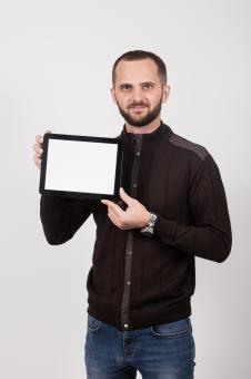 Free Stock Photo of Man Holding a Tablet