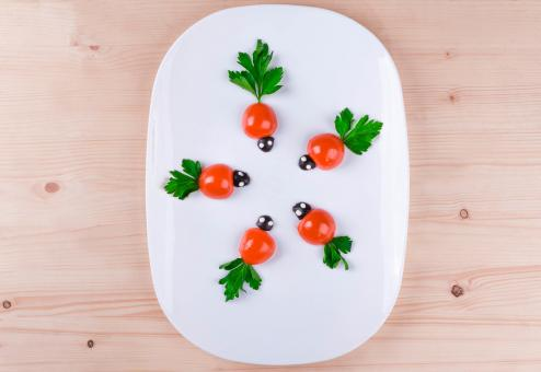 Free Stock Photo of Baby Tomatoes on a White Plate