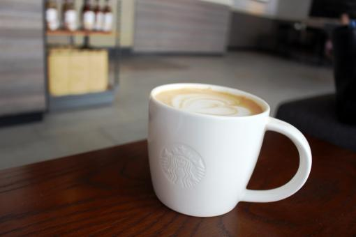 Free Stock Photo of Cup of hot coffee in Starbucks with logo on the cup