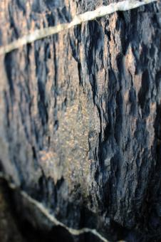 Free Stock Photo of Black rock texture with white veins