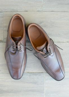 Free Stock Photo of Brown Business Shoes on Wood Floor