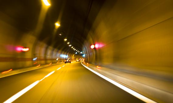 Free Stock Photo of Driving Fast Inside the Tunnel