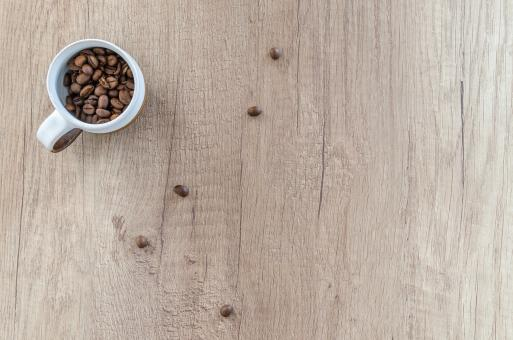 Free Stock Photo of Cup of Coffee Beans on Wooden Background