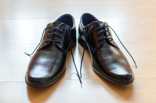 Free Stock Photo of Black Men's Shoes with Open Laces