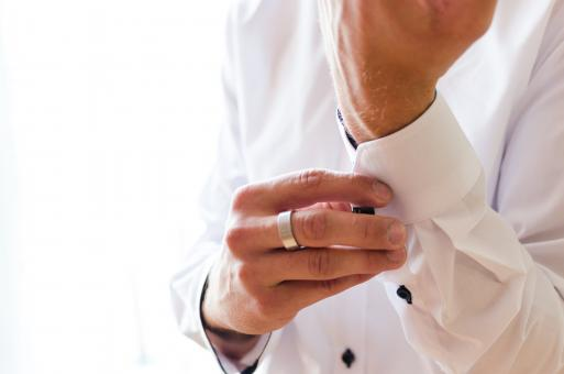 Free Stock Photo of Man Buttoning His Shirt Sleeves