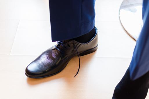 Free Stock Photo of Man Putting on His Shoes