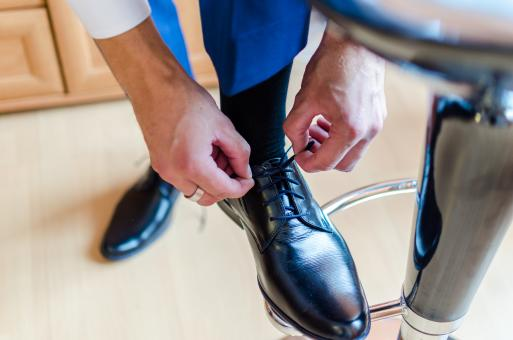 Free Stock Photo of Man Tying his Shoes