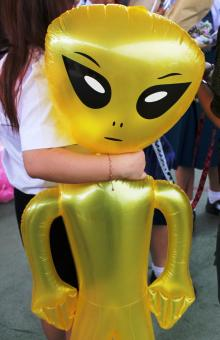 Free Stock Photo of Girl holds an inflatable alien toy
