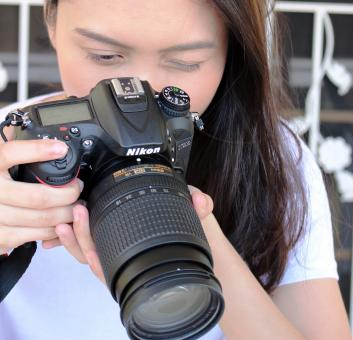 Free Stock Photo of Asian girl takes photo with a Nikon D7200 DSLR camera