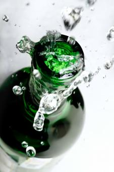 Free Stock Photo of Water Splash from Glass Bottle
