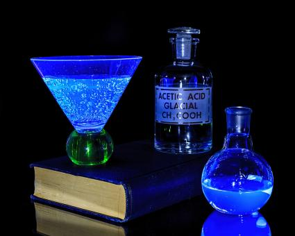 Free Stock Photo of Liquid Chemicals under a Black Light