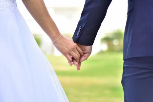 Free Stock Photo of Couple Holding Hands in Wedding Ceremony