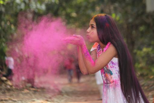 Free Stock Photo of Girl Blowing Pink Powder From Her Hands
