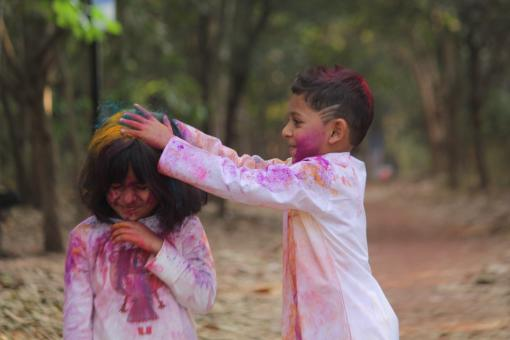 Free Stock Photo of Young Boy Putting Color Powder in Girls Hair