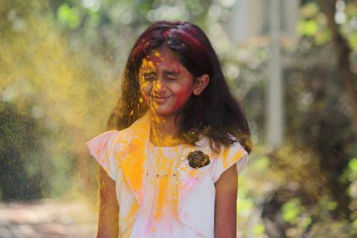 Free Stock Photo of Young Girl Covered in Yellow Powder