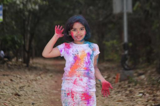 Free Stock Photo of Young Girl Covered in Colors