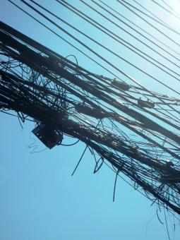Free Stock Photo of Detail of tangled overhead cables and electronics