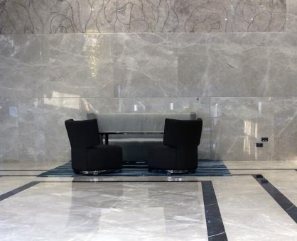 Free Stock Photo of Sofa and Chairs in a Marble Hotel Lobby