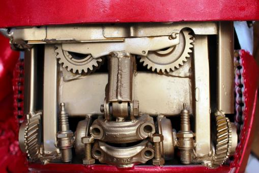 Free Stock Photo of Mechanical cogs and gears that look like a robot face