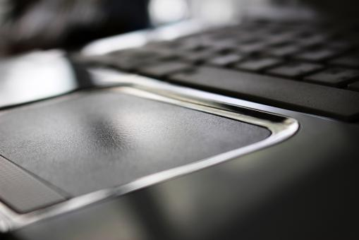 Free Stock Photo of Close-up detail of a white laptop computer mouse pad