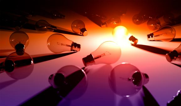 Free Stock Photo of The Brightest - A Bright Light Bulb Among Others