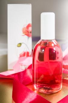 Free Stock Photo of Bottle of Red Cosmetics