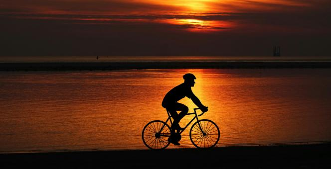 Free Stock Photo of Cyclist Silhouette at Sunset