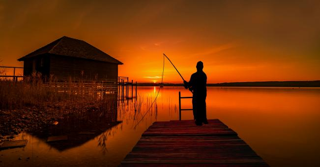 Free Stock Photo of Silhouette of Fisherman