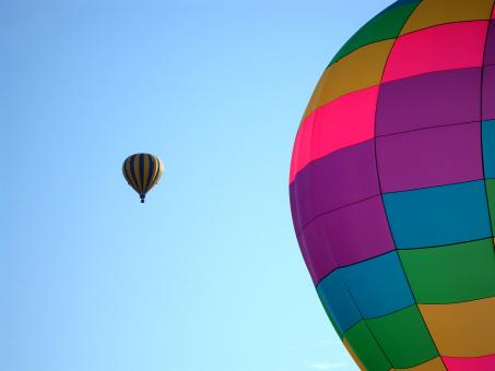 Free Stock Photo of Bright Hot Air Balloon with another Balloon in Background