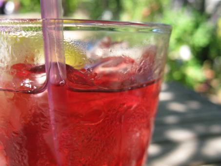 Free Stock Photo of Close-up of Red Summer Drink in Clear Glass with Straw