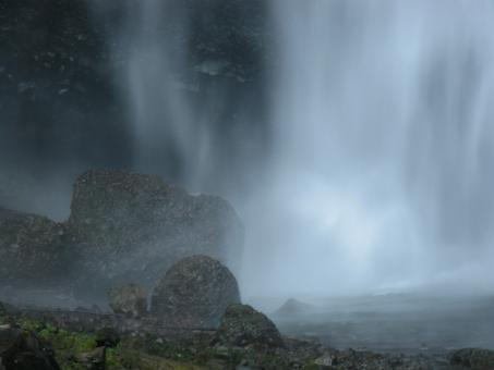 Free Stock Photo of Misty Waterfall with Dark Rocks in Foreground