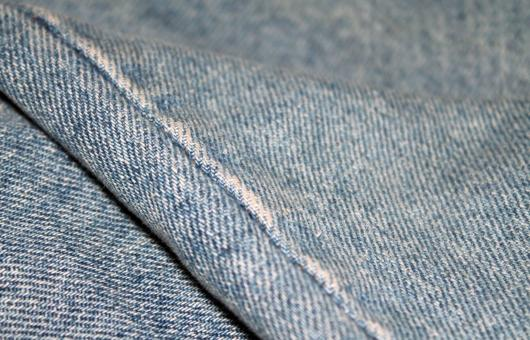 Free Stock Photo of Denim textile with a seam