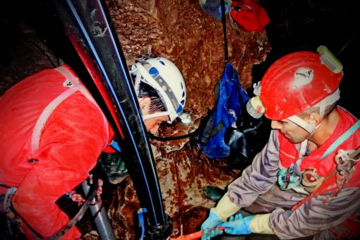 Free Stock Photo of Speleology - Cave Explorers Working Inside a Cave - Scientists - Cent